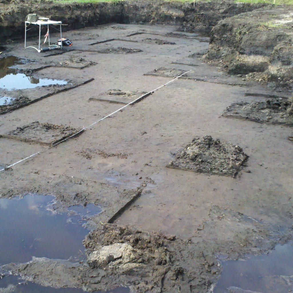 Een werkput voor de opgraving, een voorbeeld van systematisch opgraven.